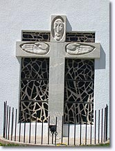 Larche, crucifix on the facade of the church