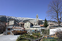 Méailles, village, bell tower and snowy mountains