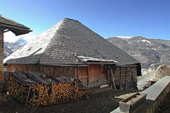 Les Orres, typical chalet with its wood pile