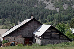 Nevache, typical chalet with its wood pile