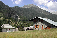 Nevache, chalets and mountain landscape