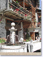 Saint Veran, fountain and flowered balcony