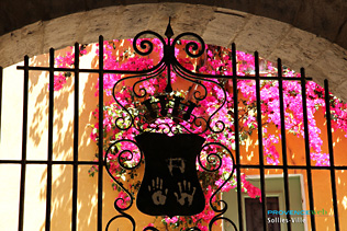Sollies-Ville, bougainvillea and wrought iron coat of arms