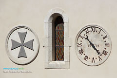 Saint Roman de Malegarde, clock on the pediment of the church